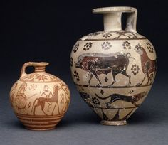 Pottery aryballos decorated with a deer hunt.  Pottery aryballos decorated with three friezes of hounds, lions and boars and dot-rosettes.