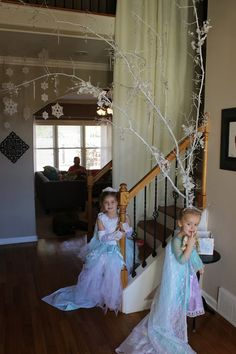Frozen party - love the branch with snowflakes hanging