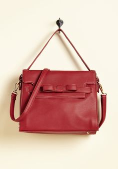 Bow-Profile Lifestyle Bag. Your usual activities err on the side of chill, but while out in the company of this red purse, you just cant help but generate attention! #red #modcloth