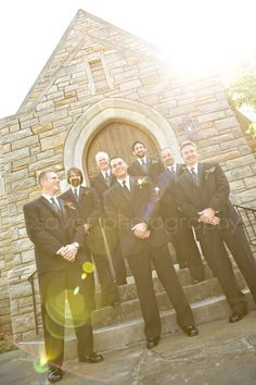 groomsmen pose. folded front hands