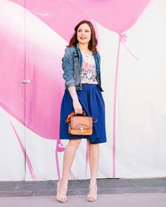 While this look may be casual, we can't help but notice how feminine and romantic it is as well. Susana from Fashion In The Street shows us the right way to mix midi skirts, graphic tees and a denim jacket and still feel ultra girly! 4/20/16