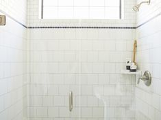 Gorgeous glass walk-in shower with subway tiled shower surround accented with stripe of black penny tiles as well as corner shower shelf with seamless glass door. White Bathroom Tiles, Bath Tiles, Bathroom Kids, Bathroom Renos, Bathroom Layout, Shower Tiles, Kids Bath, White Tiles, Bathrooms