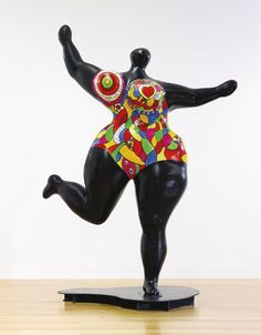 Niki de Saint-Phalle | BLACK STANDING NANA signed, dated 95 and numbered 1/1 polyester resin and acrylic on fiberglass with metal base 113 by 84 by 44 1/2 in. 287 by 213.3 by 113 cm. Executed in 1995. | Sotheby's