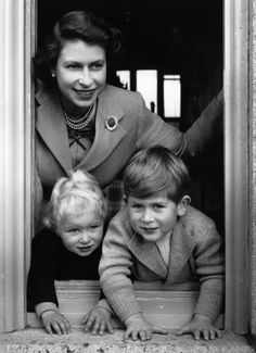 In this adorable photo of the royal family, the queen poses with her oldest children, Princess Anne and Prince Charles.