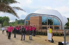 """7.2.114 - Solar Decathlon 2015: Solar Vie – Solar Life in Versailles - """"La Cité du Soleil, can be found between now and July 14 in the parc du château de Versailles. While the solar city became a reality over a short 10-day period, it was actually a project two years in the making. The project is the Solar Decathlon Europe, which evolved from the original U.S. Department of Energy Solar Decathlon."""""""