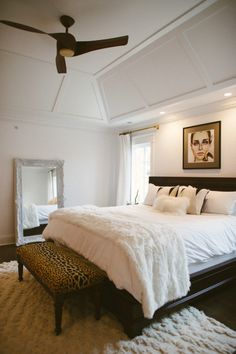 Chic bedroom features art over chocolate brown bed dressed in soft white bedding and white faux fur throw blanket as well as leopard bench at foot of bed next to white baroque floor mirror. Style Me Pretty Living, White Bedroom, Master Bedroom, Girls Bedroom, Lux Bedroom, Bedroom Neutral, White Bedding, Dream Bedroom, Master Bath