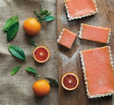 Blood Orange dessert bars. Now in season, the deep crimson flesh of Italian blood oranges turns sunset pink when made into curd. Cradled in a nutty browned butter shortbread crust, it's exactly what we want on a warm winter's day.