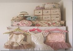 Hat box, hats, chippy paint draws, floral covered box, pink coat hangers, pink tutus