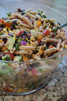 Mexican Pasta Salad - A new twist on pasta salad. This recipe ACTUALLY makes enough for a crowd. The light, citrusy dressing is just perfect.