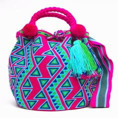 Wayuu Mochila bags Handcrafted by the indigenous Wayuu Tribe in South America. Style: Mochila Bucket Bags with Tassels and drawstring enclosure. Tapestry Crochet Patterns, Ethnic Bag, Tapestry Bag, Boho Bags, Filet Crochet, Cross Stitch Charts, Handmade Shop, Straw Bag, Purses And Bags