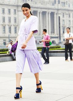 Lavender top and pants, blue and yellow heels, and purple clutch
