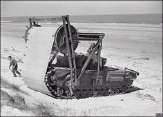 """-High water fording tanks """"BARV"""" Beach Armoured Recovery Vehicles Laid down a track for the tanks to roll over the clay beaches."""