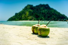 Endless summer - This photo was taken during our trip to Thailand. We went for a excursion around island in Ao Nang area. Someone left their coconuts and went swimming. It reminds me this fantastic place and time.