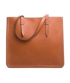 Shopper in smooth vegetable tanned calf leather. Lined with soft brown goat suede and two pockets with zippers. 35 x 12 x 38