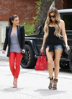 Kim Kardashian and Khloe Kardashian stepped out for lunch together in Calabasas, Calif. on April 25, 2014. Kim donned a pair of red leather pants, while Khloe opted for super short denim shorts.