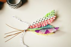 Feathers from washi tape from a bit of sunshine....mops nametags?