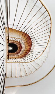Elegant white wooden stairs at Hotel Triest in Vienna, Austria - Design Hotels