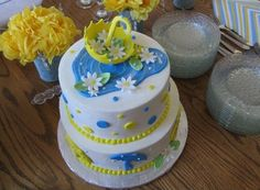 April Showers Baby Shower Cake - Two tier cake with gumpaste umbrella and fondant accents