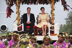 William and Kate are carried on thrones after their arrival at Funafuti in Tuvalu