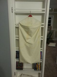 DIY hanging laundry basket 1st attempt. I dont have a pattern. I just pieced it together to fit over a wooden hanger.