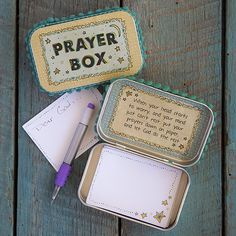 """This celestial inspired Moon and Stars tin <strong>prayer box</strong> features a vintage moon and star print on top, with blue pompom trim. These <strong>prayer boxes</strong> all feature this nurturing message inside: """"When your head starts to worry, and your mind just cant rest, put your prayers down on paper and let God do the rest."""""""
