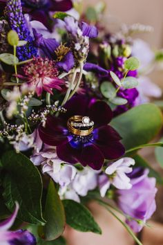 Deep purple wedding bouquet. diamond engagement ring and diamond wedding band at this Maine barn wedding #asweetstartweddings #weddingrings #purpleweddingbouquet #weddingbouquets