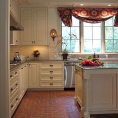 farmhouse kitchen with red brick floors