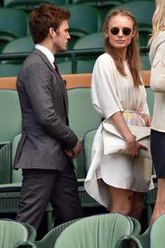 2014 Laura Haddock wore a slinky white dress with an envelope clutch as she attended a match with Sam Claflin.