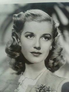 Vintage 1940 Hair and Makeup, don't know the model but she's a beauty