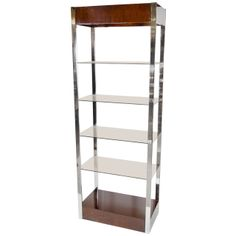 Luxe Mid-Century Modernist Etagere In Chrome and Book-matched | From a unique collection of antique and modern bookcases at http://www.1stdibs.com/furniture/storage-case-pieces/bookcases/