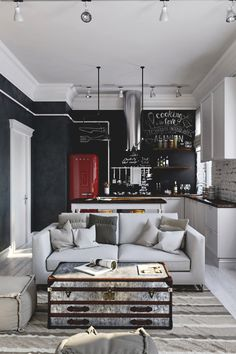 (via grandpalaces) - MEN STYLED. Open kitchen and living room. Black wall. Smeg fridge.
