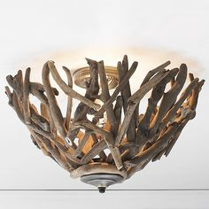 Reclaimed Driftwood Basket Ceiling Light Abstract driftwood bowl serves as sculpture for your ceiling, casting entrancing patterns of light all over the room. Each one is uniquely handmade