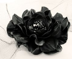 Hey, I found this really awesome Etsy listing at https://www.etsy.com/listing/120344123/black-leather-rose-flower-brooch