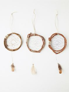 "Mini Wood Dreamcatcher | Handmade mini wood dreamcatcher with metallic thread and thin rope detailing. Little feather hanging from middle. Sold as a single. *By Catherine *3"" diameter"