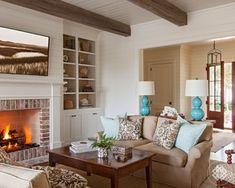 reclaimed ceiling beams, antique coffee table, custom upholstery, vintage lantern