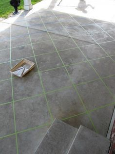 back patio makeover using tape and concrete stain. Brilliant!