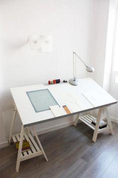 slanted desk = drawing board...i really think i'll need this