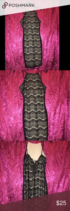 Black / cream lace dress Dress is a great fit and super comfy. Ties in the back. Dresses