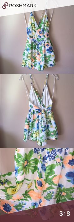 Depri Floral Romper open back Very pretty, lined romper with adjustable straps and back zipper; pockets in front. Partial tag attached. Check out the $6 section of my closet (before the sold items). Lots of bundle-worthy $6 items! 15% bundle discount on 2+ items in a bundle.NO TRADES Depri Pants Jumpsuits & Rompers