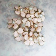 This is a lot of 12 Cute tiny flower buttons with shanks for sewing, for dainty jewelry making, and for creating embellishments and accessories.These buttons have very large and square 8 mm shanks.- 10 mm- White and gold colors.- Made from res... Button Flowers, Tiny Flowers, White Flowers, Bracelet Making, Jewelry Making, Fancy Buttons, Pink Petals, Dainty Jewelry, Flower Shape