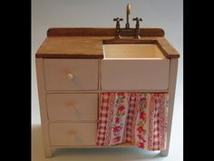 This 1/12th scale sink unit looks great in a country style or farmhouse kitchen. I have painted mine cream with an oak draining board, but it also looks good...