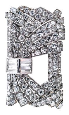"""Art Deco French Diamond Rectangular Brooch. This unique French Art Deco design is composed by a bold rectangular motif filled with courses of round diamonds gently cascading around a central opening juxtapositioned with baguette diamond motifs, the look is tres avant-garde, 100% Diva. There are One hundred forty-six glittering diamonds that total approximately 10.00 carats, mounted in platinum, French hallmarks, dimensions: 1 3/4"""" X 1 1/8"""" overall. Circa 1930's"""