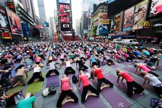 Thousands of yoga enthusiasts convene in New York's Times Square to mark the summer solstice