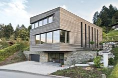 A little boxy and dominated by the garage below -but a good example of concrete and stone base, wooden upper floors, monopitch roof, but don't like the horizontal cladding Temporary Architecture, Minimalist Architecture, Architecture Design, Facade House, House Roof, Wood Facade, Modern Townhouse, House Goals, New Homes