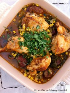 Smoked Paprika Braised Chicken with Andouille Sausage, Corn, Greens and Fresh Cilantro - dutch oven recipe!