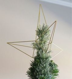 DIY Himmeli-Style Christmas Star Tree Topper by ehow: This geometric Himmeli-style star sculpture requires minimal supplies and is simple to construct — so crank up the holiday tunes and get started!... #DIY #Christmas #Tree_Topper