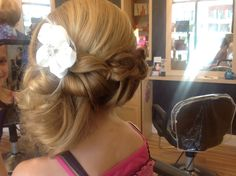 Hairstyle created by Anita of Salon International braided side half up half down