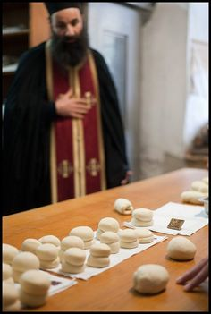 At the Bakery La Brutărie Στο Αρτοποιείο English One of the most traditional things in a Monastery is the process of making prosfora (Oblation Bread) for Liturgy. The monks do themselves all the th…