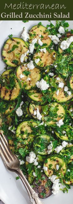 Mediterranean Style Grilled Zucchini Salad | The Mediterranean Dish. Simple, flavor-packed grilled zucchini with fresh herbs and other Mediterranean favorites. Ready in 15 minutes. Recipe from TheMediterraneanDish.com