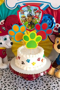 Make a super easy and super quick Paw Patrol party cake with the help of a grocery store cake and pre-printed and cut paper items. #diypartyplanning